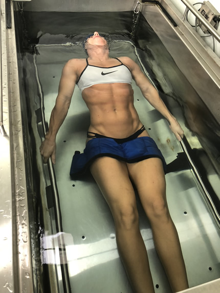 Woman in hydtrostatic body fat testing water tank